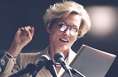 woman giving a speech at a conference