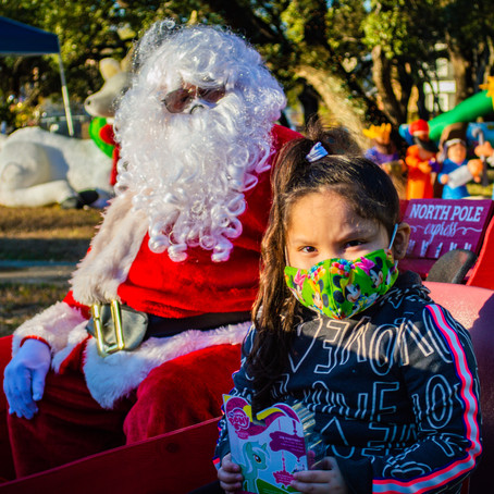 All Smiles at the Sleigh Stop Toy Giveaway in Southeast Austin's Dove Springs