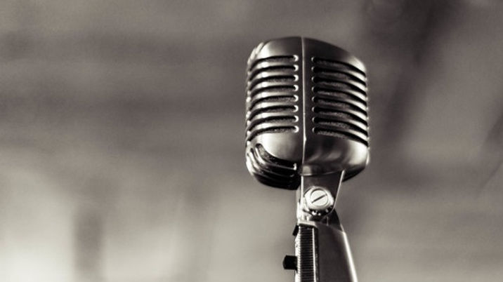 Black and White image of a vintage microphone