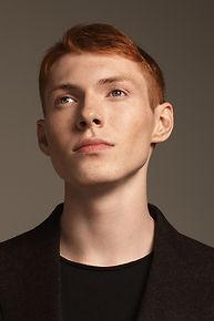 El muchacho de pelo rojo
