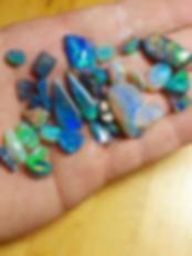 Opal Rubs in Hand.png