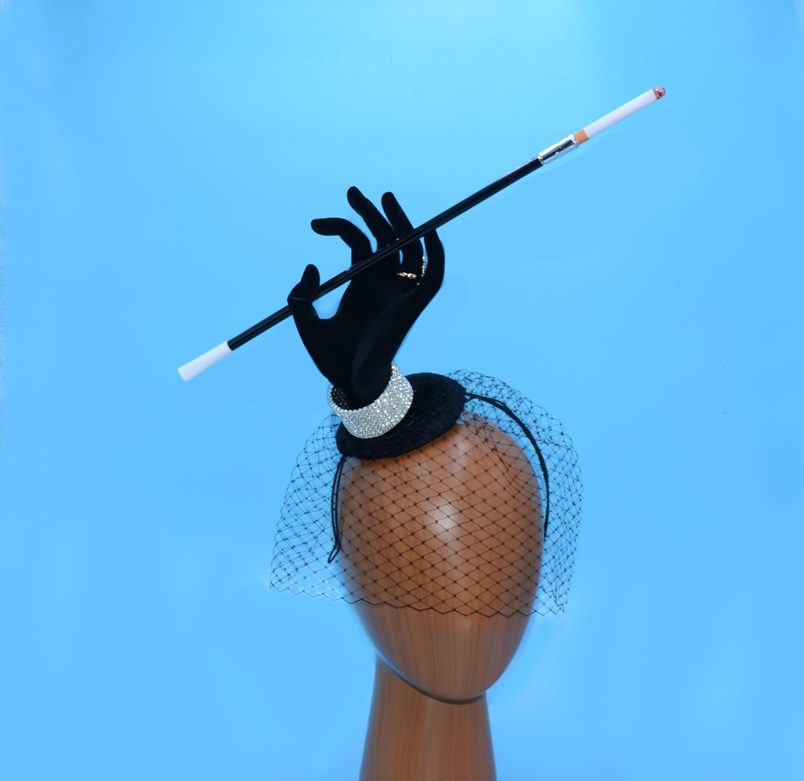 Surreal Smoking Hand Fascinator Hat Cost