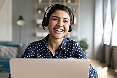 Cheerful indian woman wear headset laugh