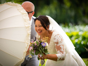 Bride walking with her parasol