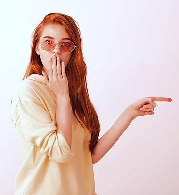 shocked-and-astounded-redhead-girl-point