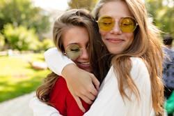 lovely-happy-girls-walking-outside-in-su