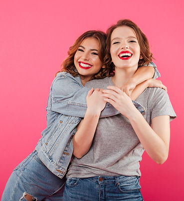 happy-two-women-friends-hugging_edited_e