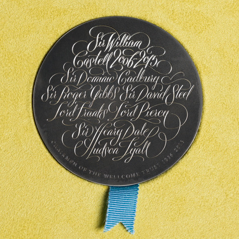 Hand-lettered medal-engraved calligraphy for Wellcome by Bret Syfert