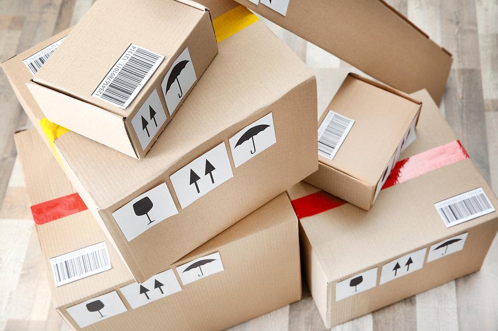 Cardboard boxes on wooden floor.jpg