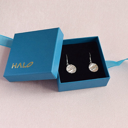 Sterling silver round textured earrings