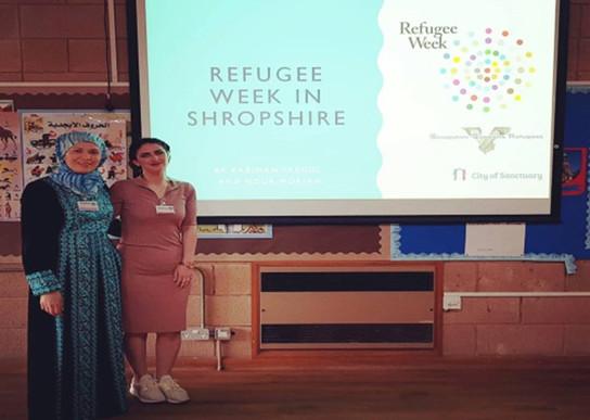 Volunteers giving a talk