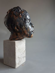 """Thinking of you "" Stoneware ceramic head of a girl with a flower in her hair.  French limestone base  by Sharon Griffin"