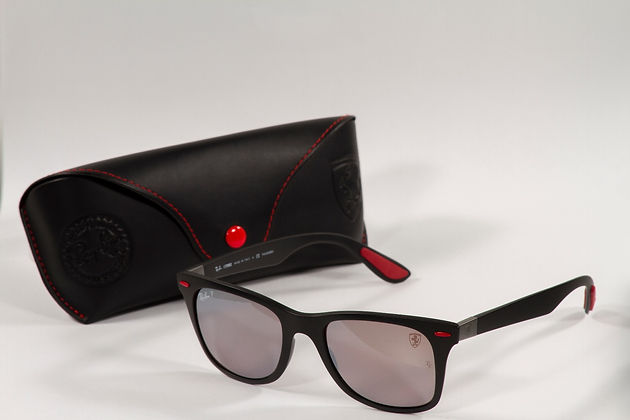 2f050e5211 The front is a very classic Wayfarer design we are familiar with but in  this rendition the signature Ferrari red coloured shields in the corners of  the ...