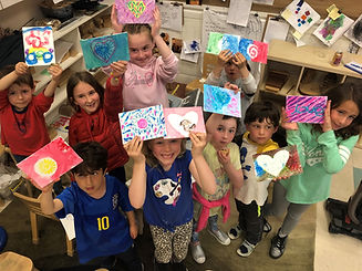 first graders with paintings for new moms .jpg