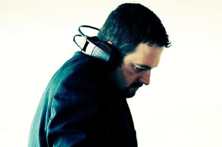 DK in Suit with headphones mixing 480 pi