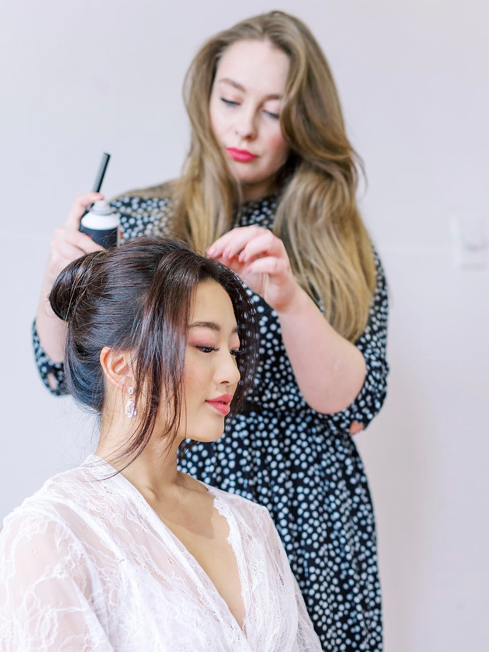 Alisha Hopps is working with her model on a bridal trial