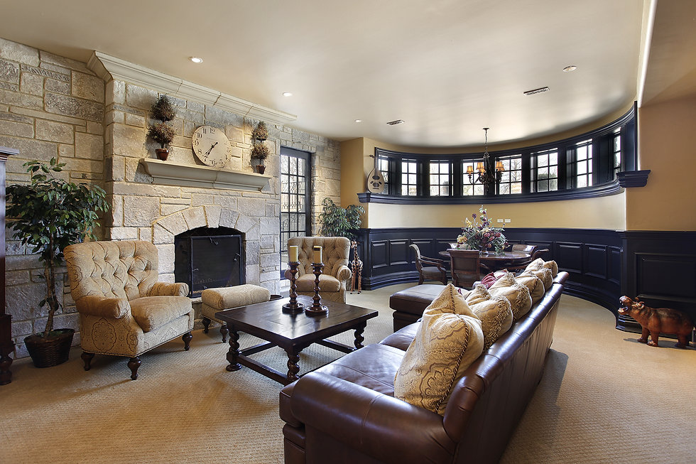 Basement in luxury home with stone firep