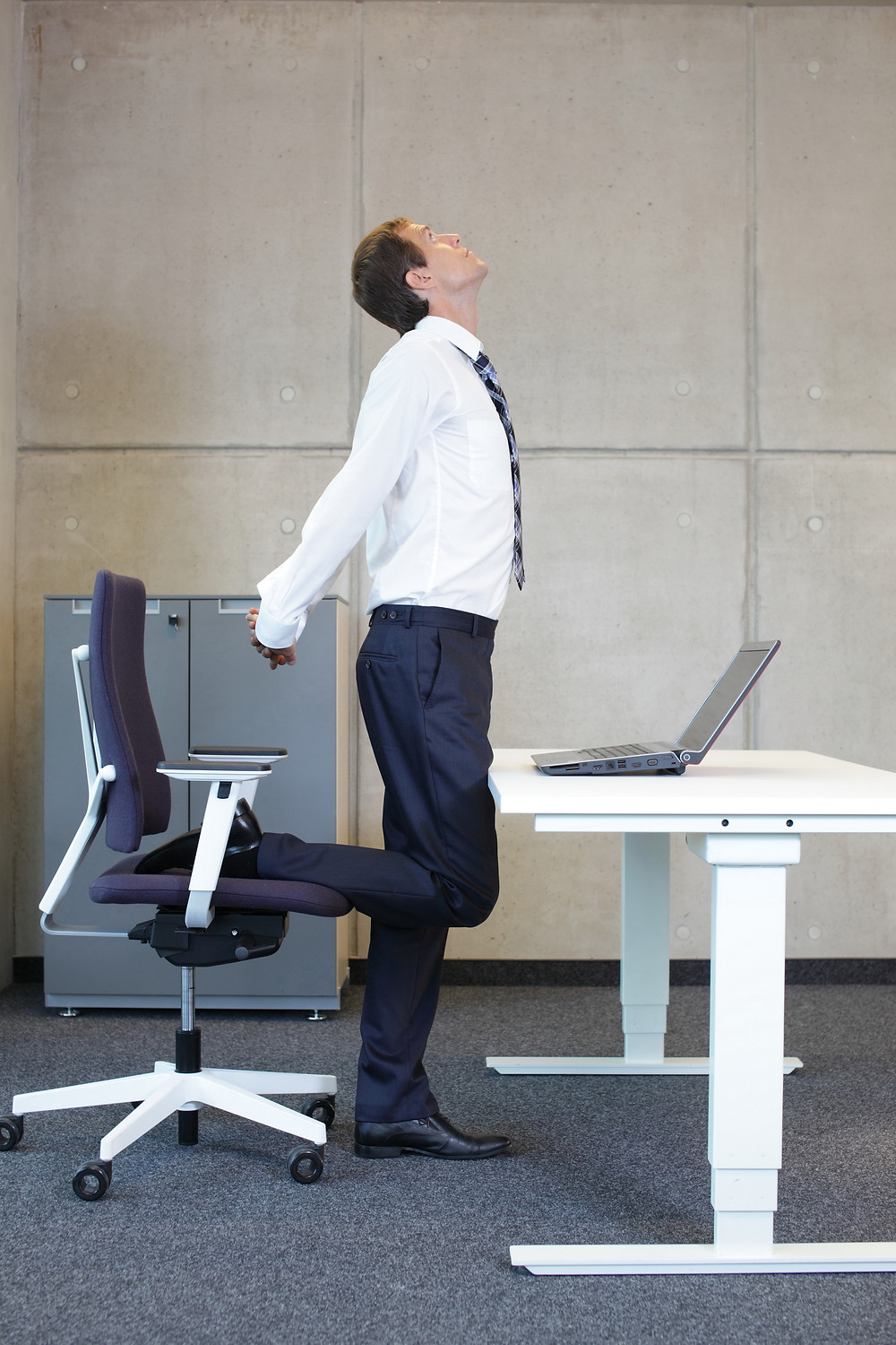 Prevent pain with desk stretches. Example standing hip flexor and chest stretch.
