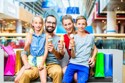 37893838-family-eating-ice-cream-in-shop