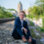 Senior portrait on the train tracks by the Fisher Building in New Center, Detroit, Michigan