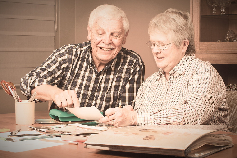 Senior couple talking about family history