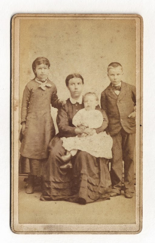 Caroline Pusecker Mack with three  of her children.