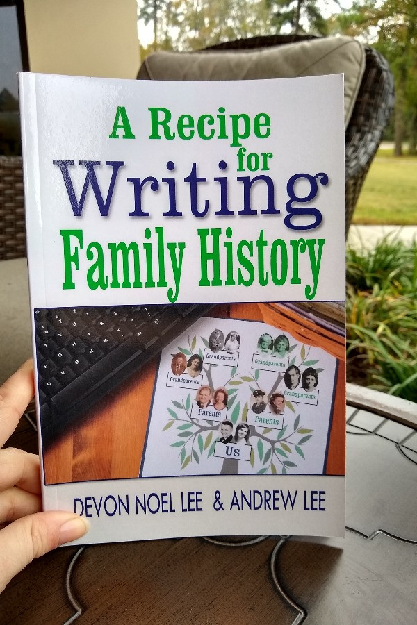 Hand holding book A Recipe for Writing Family History