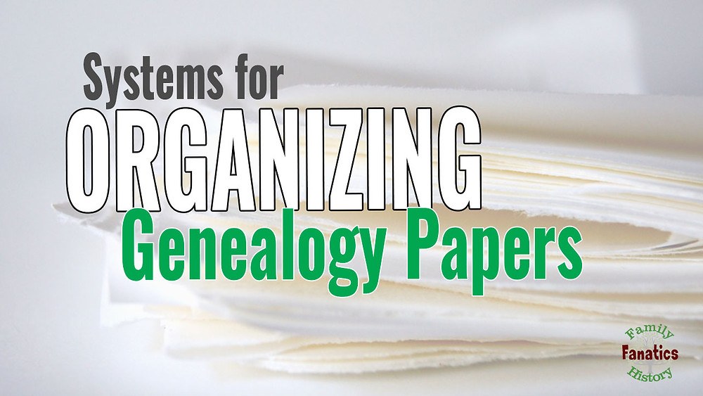 pile of papers with phrase systems for organizing genealogy piles