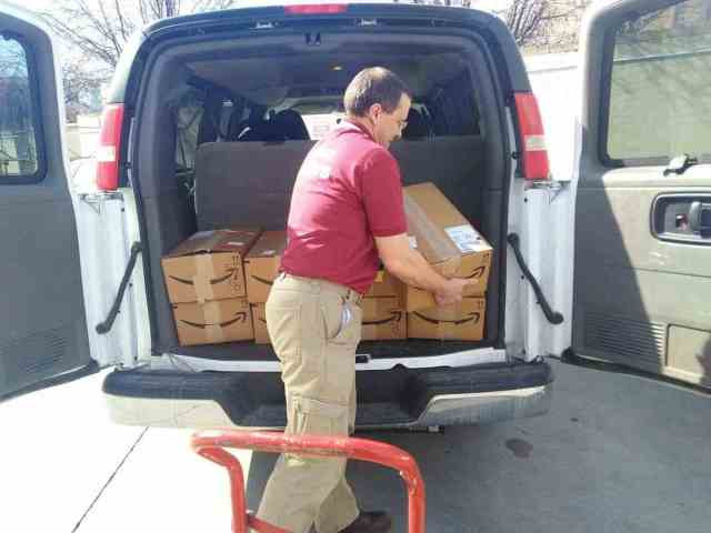 Family History Fanatics unloading product boxes at RootsTech