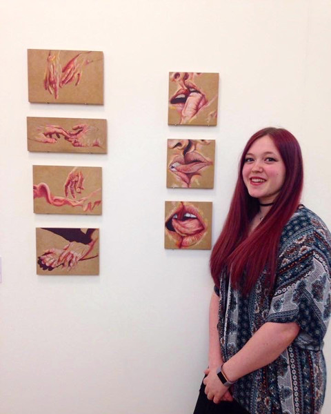 Casey with her work at the HUMAN Exhibition