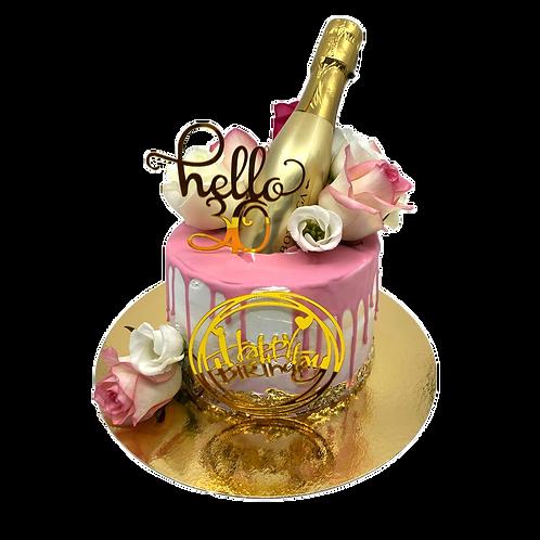 Gouden birthday drip cake