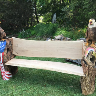 I milled these bench slabs myself.  They're from a large Chestnut Oak tree.  I used an Alaskan Chainsaw Mill. The eagles are carved from White Pine.