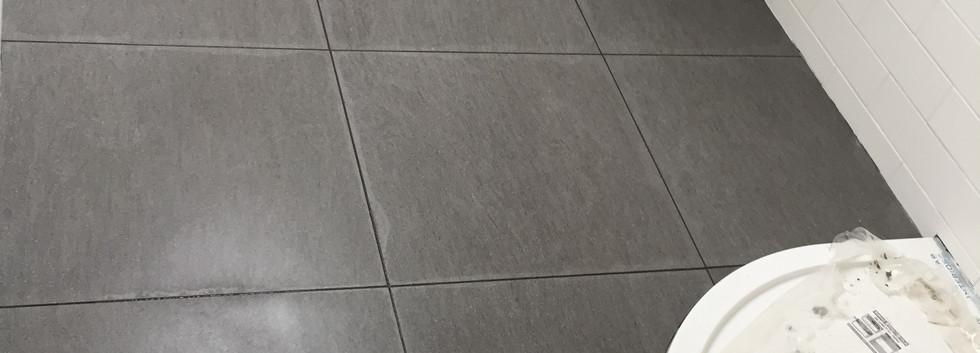 Tiling shower room in London
