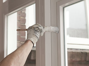 Painting a wooden window with white pain