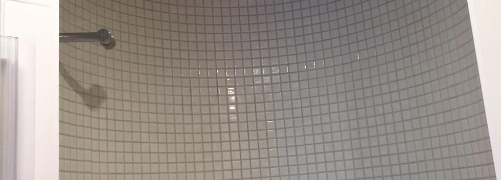Shower room tiled in mosaic tiles