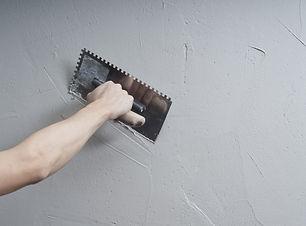 _Hands Plasterer at work. Application of
