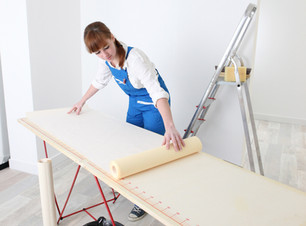 Decorator measuring wall paper.jpg