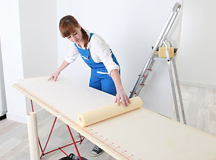 Decorator measuring wall paper.jpg