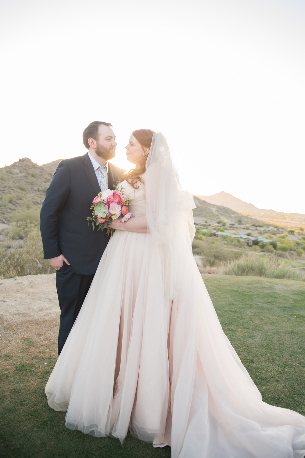 The bride and groom with the beautiful Arizona mountains behind them.