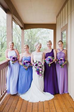 Varied purple bridesmaid dresses