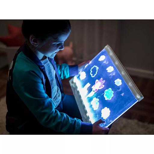 girl holding light up board crayola gift for kids