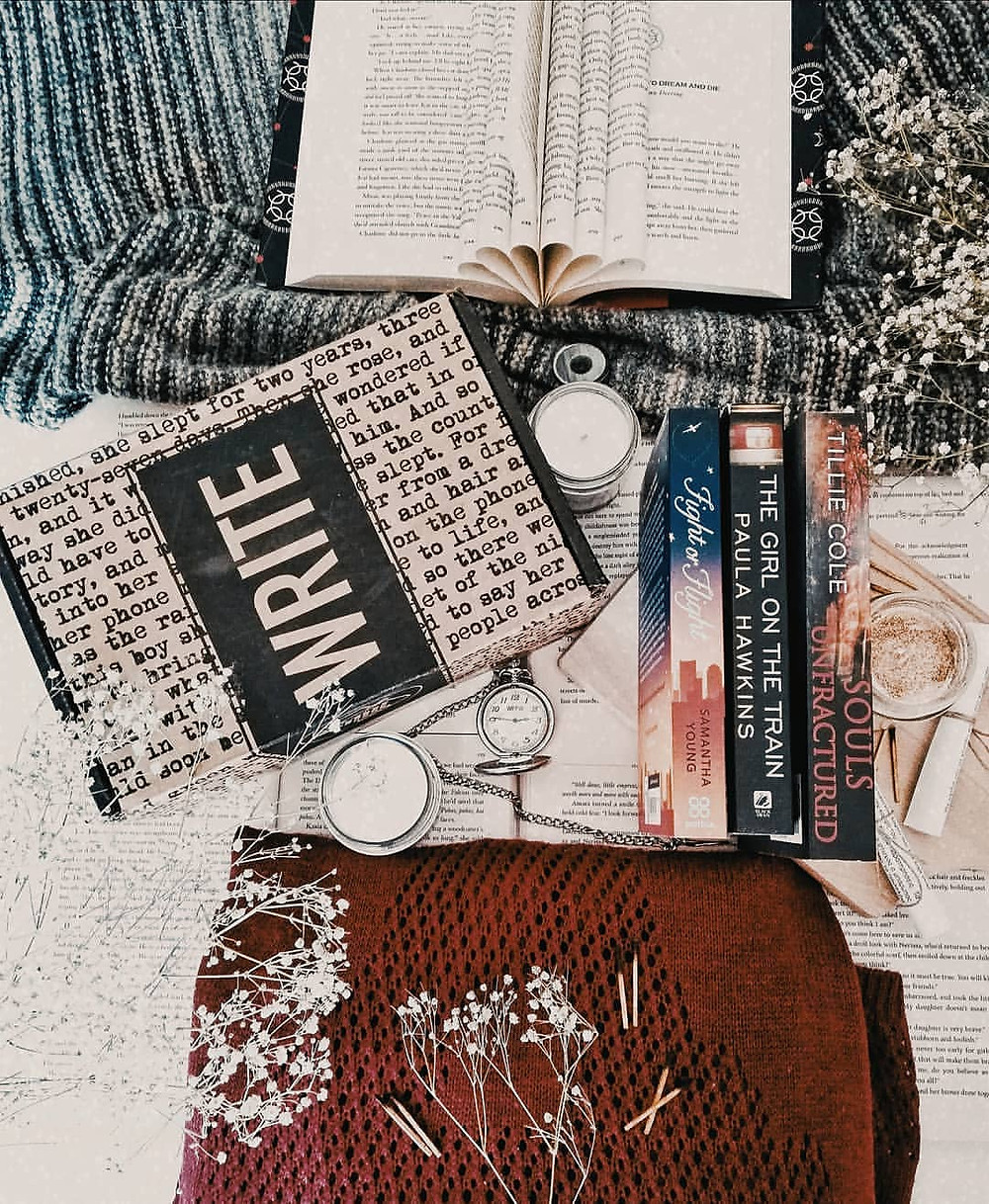 Scribbler subscription box with three books on table with blankets