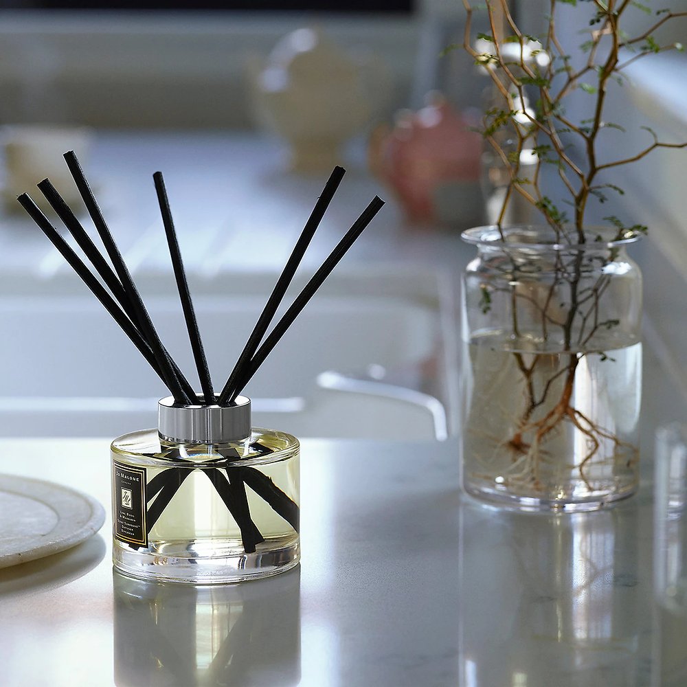 Jo Malone glass reed diffuser on a white table
