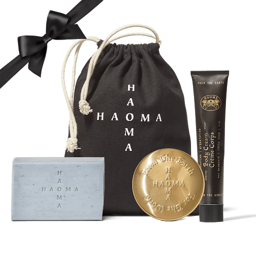 blue bar of soap gold tin and black tube with small black drawstring bag haoma skincare shen beauty