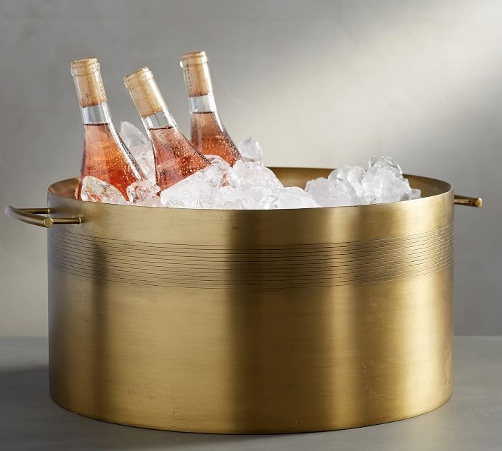large gold bucket filled with ice and bottles of wine for Thanksgiving entertaining