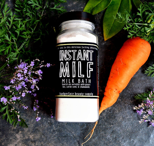 bottle that says instant milf milk bath with a carrot gift for new mom
