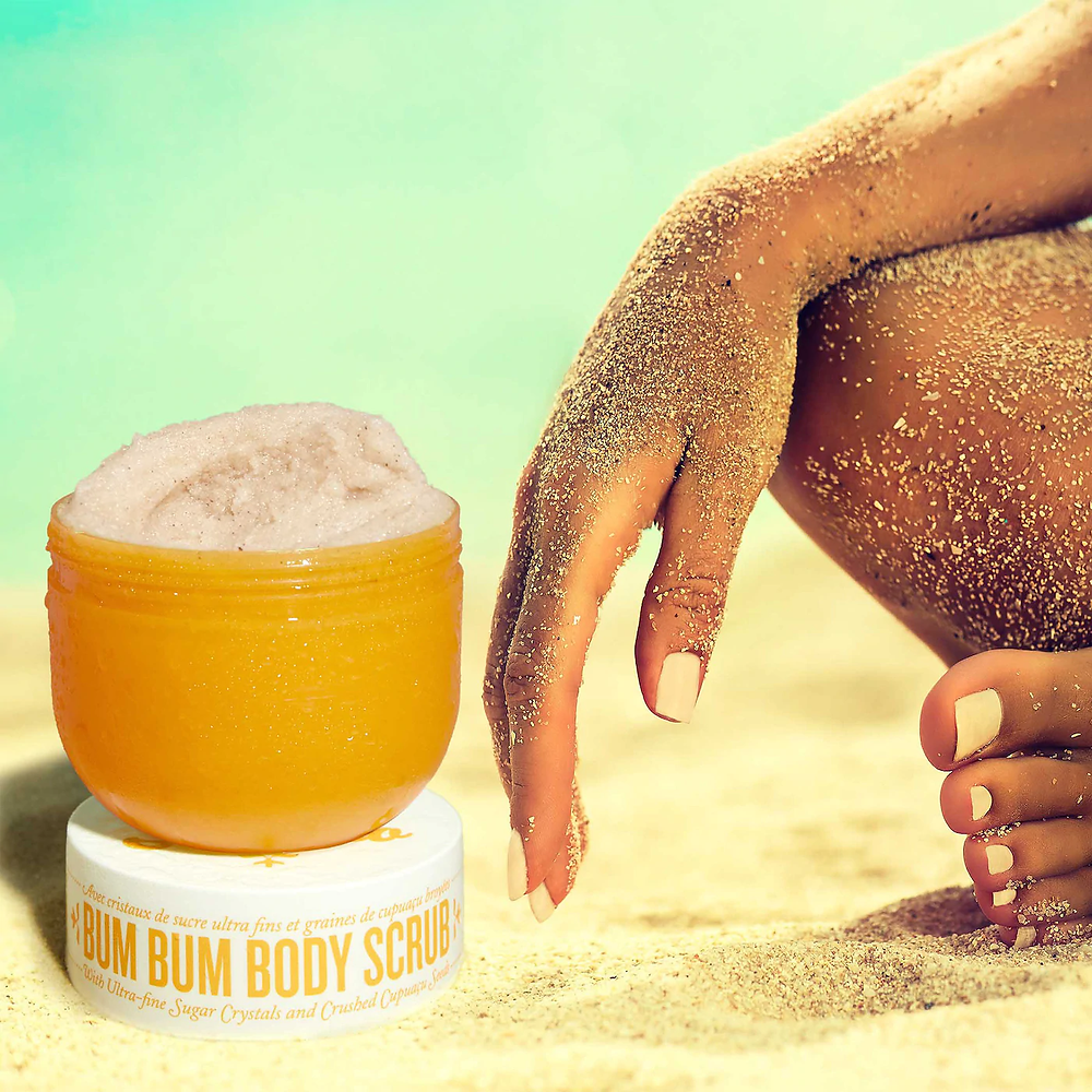 Brazilian bum bum body scrub open with sand covered woman