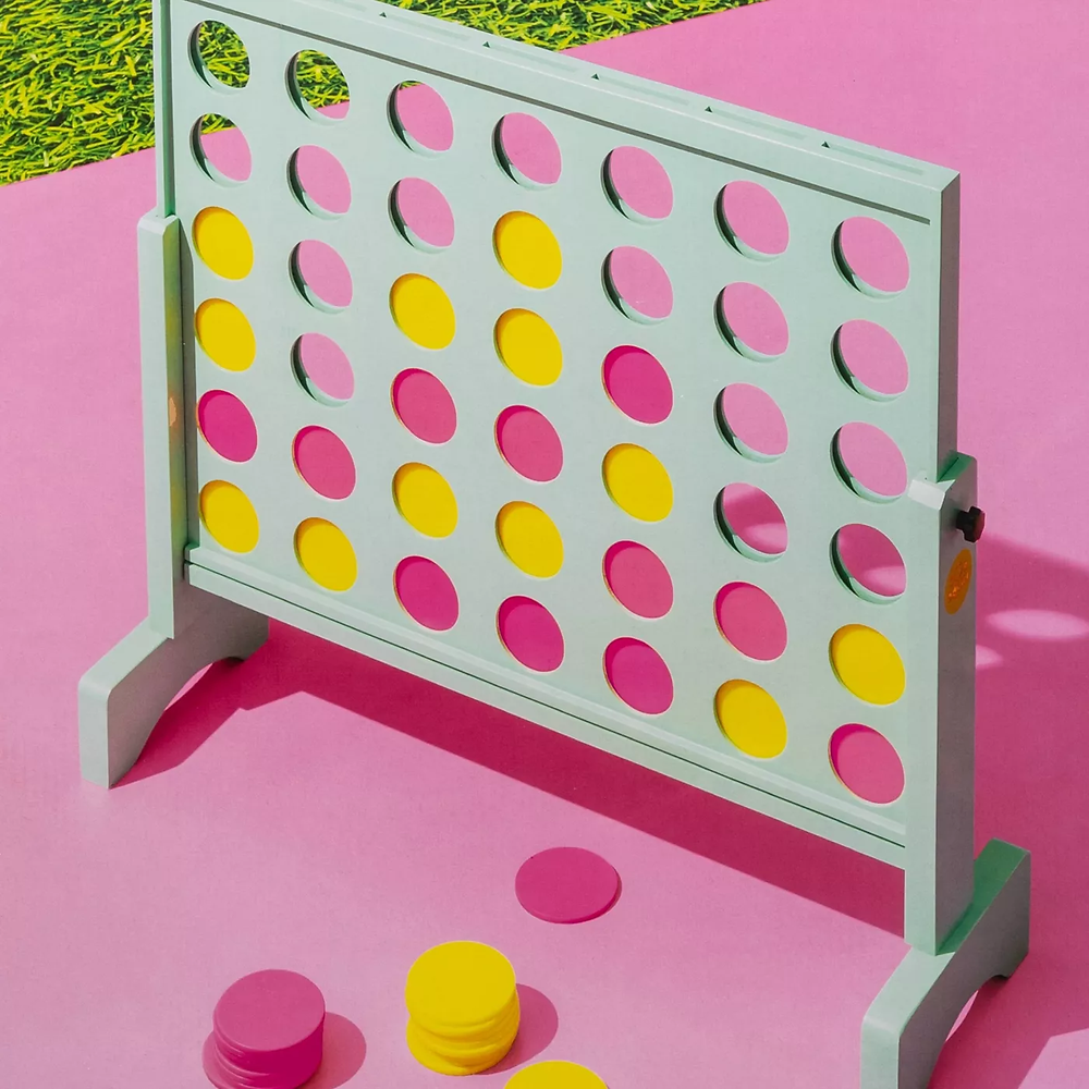 giant connect four set, pink and yellow themed