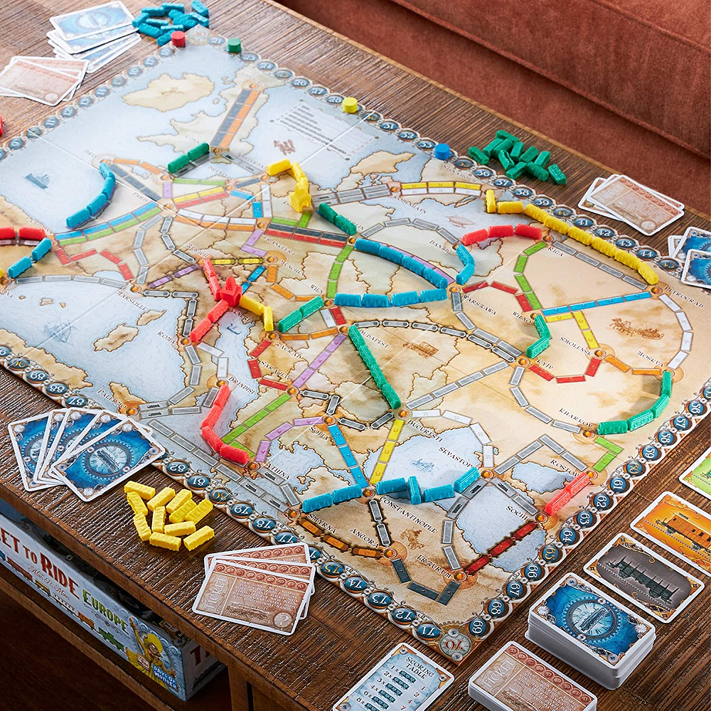 ticket to ride game on wooden table date night experience