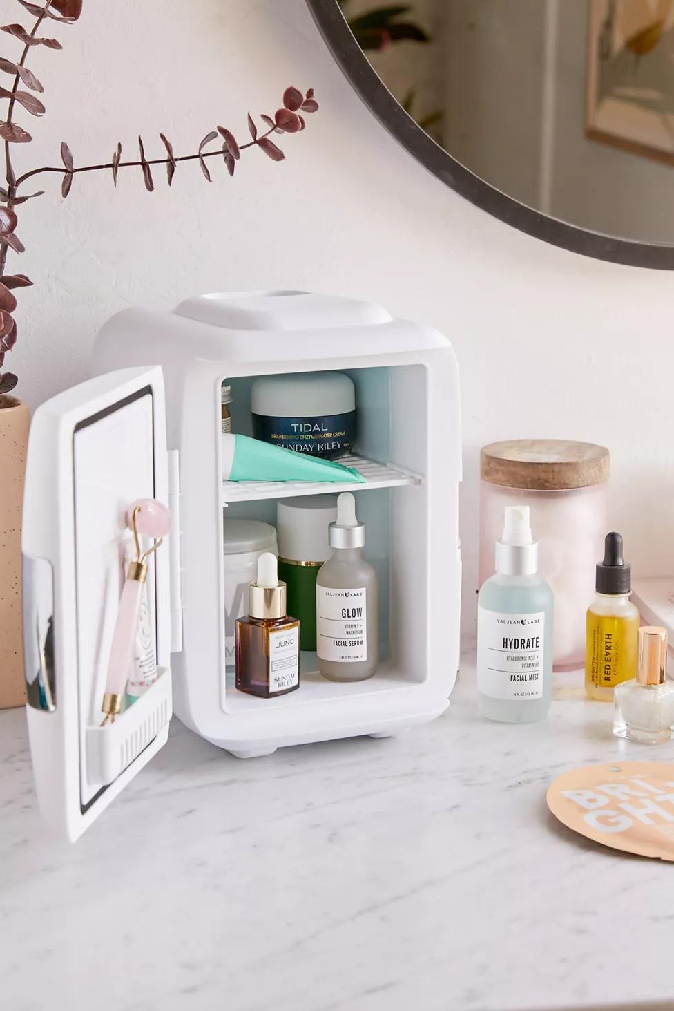 small countertop skincare fridge with skincare in it